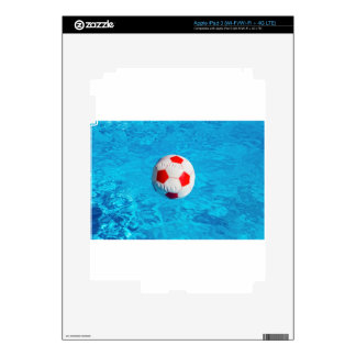 Beach ball floating  in blue swimming pool skins for iPad 3