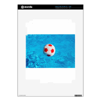 Beach ball floating  in blue swimming pool skins for the iPad 2