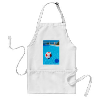 Beach ball floating on water in swimming pool adult apron