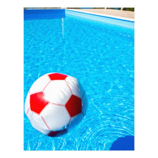 pool water with beach ball. beach ball floating on water in swimming pool letterhead with