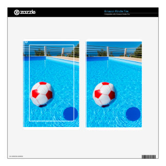 Beach ball floating on water in swimming pool skin for kindle fire