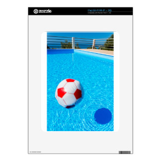Beach ball floating on water in swimming pool skin for the iPad
