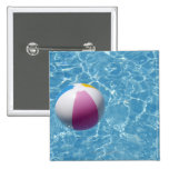 Beach ball in swimming pool button