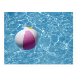 Beach ball in swimming pool post cards