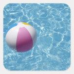 Beach ball in swimming pool square sticker