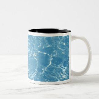 Beach ball in swimming pool Two-Tone coffee mug