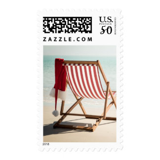Beach chair with santa hat postage