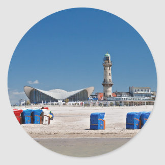 Beach chairs and lighthouse in Warnemuende Round Sticker