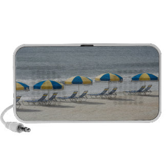 beach chairs and umbrellas travelling speaker
