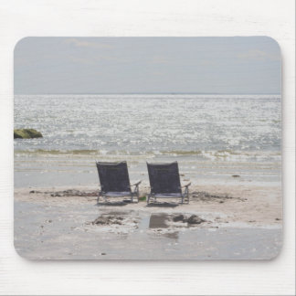 Beach chairs by the ocean mouse pad