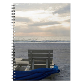 Beach chairs on St. Pete's beach at sunset. Notebook
