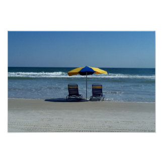 Beach Chairs on The Shoreline Poster