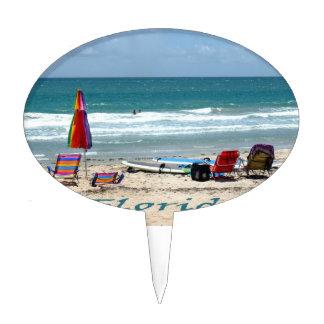 beach chairs surfboards umbrellas sand ocean cake picks