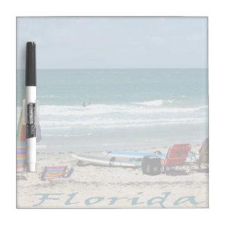 beach chairs surfboards umbrellas sand ocean Dry-Erase board