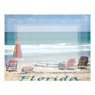 beach chairs surfboards umbrellas sand ocean letterhead