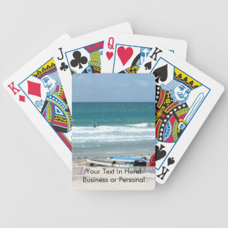 beach chairs surfboards umbrellas sand ocean sm bicycle playing cards