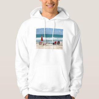 beach chairs surfboards umbrellas sand ocean sm hoodies