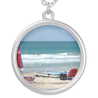 beach chairs surfboards umbrellas sand ocean sm round pendant necklace