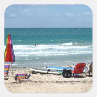 beach chairs surfboards umbrellas sand ocean sm square sticker