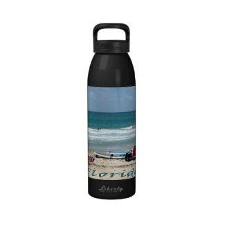 beach chairs surfboards umbrellas sand ocean reusable water bottles