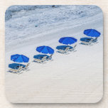 """Beach Chairs with Blue Umbrella on Madeira Beach Beverage Coaster<br><div class=""""desc"""">Beach chairs with a blue umbrella line the shoreline close to the beautiful waters of Madeira Beach. This beach in the Pinellas County of Florida in the United States is on the west coast or the &quot;gulf side&quot;. The Gulf of Mexico side of Florida is known as the more peaceful...</div>"""