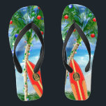 """Beach Christmas Flip Flops<br><div class=""""desc"""">Happy Holidays from the warm sandy beaches of your favorite tropical island beach. Palm tree decorated with Christmas ornaments and lights,  with a retro surfboard leaning against the Christmas tree.</div>"""