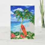 """Beach Christmas Holiday Card<br><div class=""""desc"""">Happy Holidays from the warm sandy beaches of your favorite tropical island beach. Palm tree decorated with Christmas ornaments and lights,  with a retro surfboard leaning against the Christmas tree.</div>"""