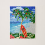 """Beach Christmas Jigsaw Puzzle<br><div class=""""desc"""">Happy Holidays from the warm sandy beaches of your favorite tropical island beach. Palm tree decorated with Christmas ornaments and lights,  with a retro surfboard leaning against the Christmas tree.</div>"""