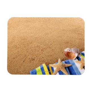 Beach corner border with towel, starfish and rectangular photo magnet