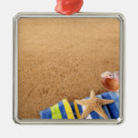 Beach corner border with towel, starfish and square metal christmas ornament