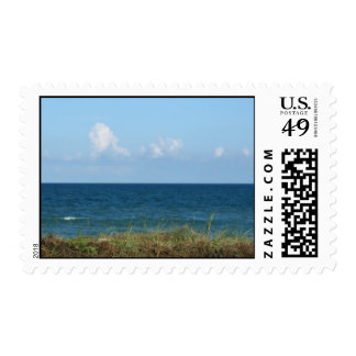Beach dune with blue water and sky, Florida Stamps