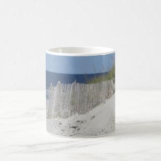 Beach fence and sandy beach coffee mug