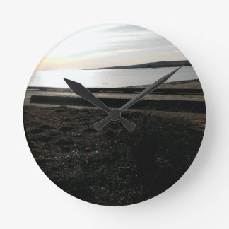 Beach front through the trees. round clock