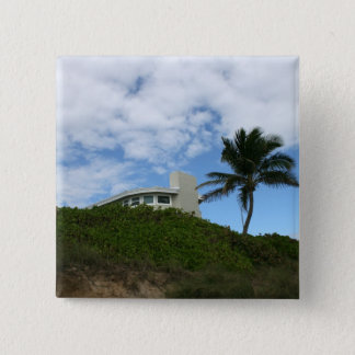 Beach House on Hill with sky and palm tree Button