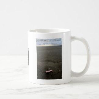 Beach litter plastic doll leg with sunrise mugs