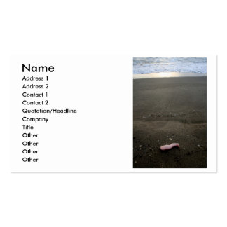 Beach litter plastic doll leg with sunrise business card