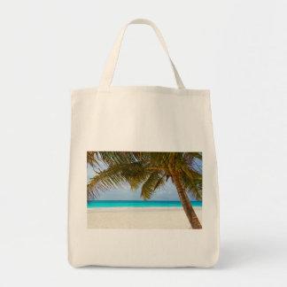 beach palm branches tree tropical island sand sea tote bag