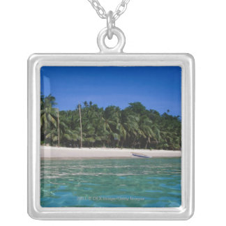 Beach, raft in a distance silver plated necklace