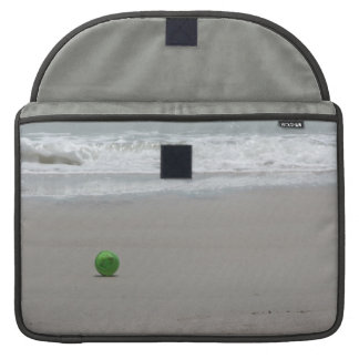 Beach, sand, waves, and green bucket sleeve for MacBooks