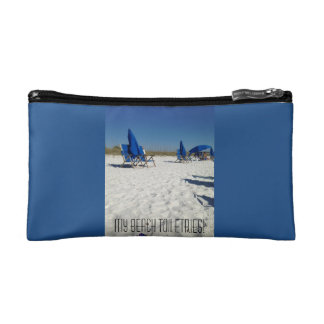 beach scene of sand and blue skies and chairs cosmetic bag