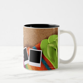 Beach scene with blank photo prints, towel, Two-Tone coffee mug