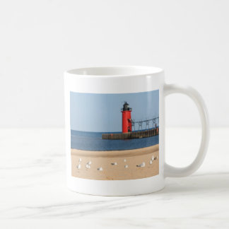 Beach scene with seagulls and lighthouse coffee mug