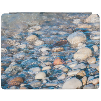 Beach stones on the lake shore iPad cover