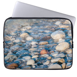 Beach stones on the lake shore laptop computer sleeves