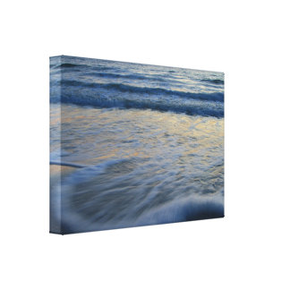 beach sunset and wave action stretched canvas prints