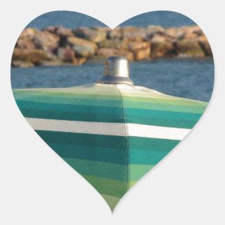 Beach umbrella on sea background heart sticker