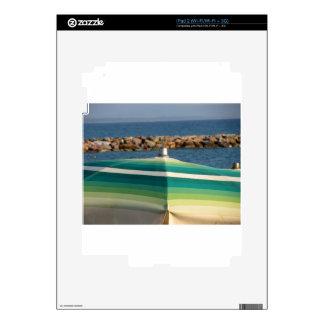 Beach umbrella on sea background skin for the iPad 2