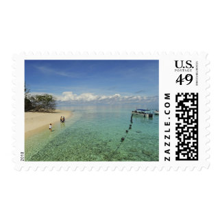 Beach with white sand and clear turquoise water postage