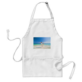 beach yoga performed by a matured asian female aprons