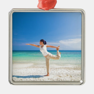 beach yoga performed by a matured asian female square metal christmas ornament